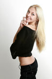 Cheerful beautiful blond girl. Beautiful young woman with long blond hair stock images