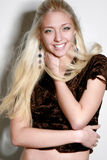 Cheerful beautiful blond girl. Young woman with long blond hair royalty free stock photo