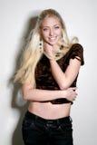 Cheerful beautiful blond girl. In black denim stock image
