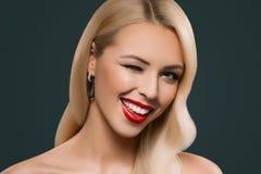 cheerful beautiful blonde winking woman, royalty free stock photos