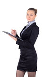 Cheerful beautiful business woman with clipboard writing, isolat Royalty Free Stock Images