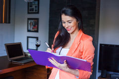 Cheerful beautiful businesswoman holding notebook . Royalty Free Stock Photos