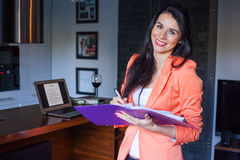 Cheerful beautiful businesswoman holding notebook . Stock Image