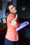 Cheerful beautiful businesswoman holding notebook . Royalty Free Stock Images