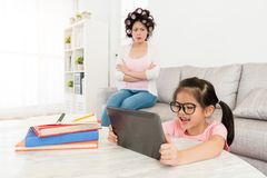 Daughter kid children using mobile digital tablet royalty free stock photo