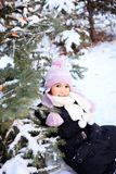 Cheerful beautiful girl in purple winter hat Royalty Free Stock Photo