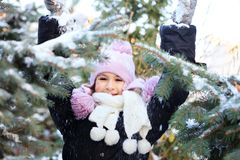 Cheerful beautiful girl in purple winter hat Royalty Free Stock Photography