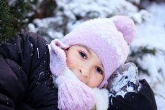 Cheerful beautiful girl in purple winter hat Royalty Free Stock Photos