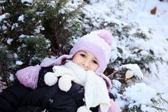 Cheerful beautiful girl in purple winter hat Royalty Free Stock Images