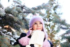 Cheerful beautiful girl in purple winter hat Stock Photography