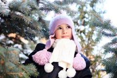 Cheerful beautiful girl in purple winter hat Royalty Free Stock Photos
