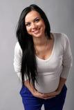 Cheerful beautiful pregnant woman Stock Image