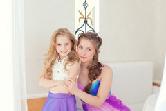 Cheerful beautiful sisters looking at camera Royalty Free Stock Photos