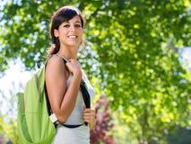 Cheerful beautiful student outside stock image