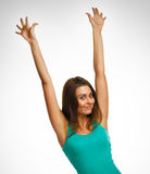 Cheerful beautiful woman raised hands up happy Royalty Free Stock Photos