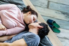 Cheerful beautiful young couple at home Stock Images