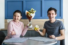 Cheerful beautiful young couple at home Royalty Free Stock Photography
