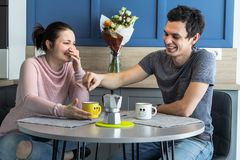 Cheerful beautiful young couple at home Royalty Free Stock Photo