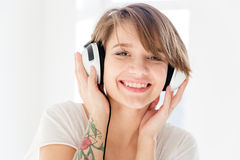 Cheerful beautiful young woman in headphones listening to music Royalty Free Stock Photography