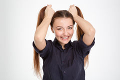 Cheerful beautiful young woman making two ponytails by hands Stock Photography