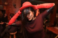 Cheerful and beautiful young woman smiling and dancing in the night club Royalty Free Stock Images