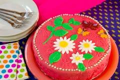 Cheerful birthday cake in still life stock image