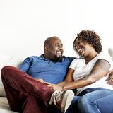 A cheerful black couple having good time stock photo