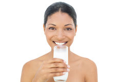 Cheerful black haired model holding glass of milk Royalty Free Stock Image
