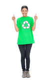 Cheerful black haired model wearing recycling tshirt giving thumbs up Royalty Free Stock Photography