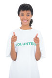 Cheerful black haired volunteer giving thumbs up Stock Photography