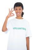 Cheerful black haired volunteer making an okay gesture Stock Image