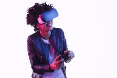 Cheerful black teenager playing VR game royalty free stock image