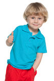 Cheerful blond boy in blue shirt Royalty Free Stock Photography