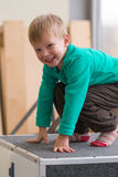 Cheerful blond boy in the gym on a pedestal Stock Photos