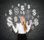 Cheerful blond businesswoman near blackboard with dollar signs Royalty Free Stock Images