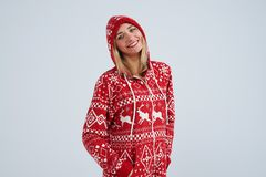 Cheerful blond in christmas pajamas. Isolated on white Stock Photography