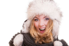 Cheerful blond girl in warm fur hat. Winter clothes & christmas. Royalty Free Stock Images