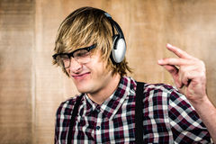 Cheerful blond hipster listening to music Stock Photo