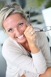 Cheerful blond mature woman Royalty Free Stock Images