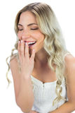 Cheerful blond model laughing Stock Images