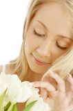 Cheerful blond with white tuli Royalty Free Stock Photography