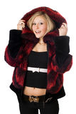 Cheerful blond woman in fur jacket. Isolated on white Stock Photography