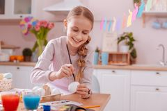 Cheerful blonde girl turning on her imagination. Pleasure emotions. Amazing teenager expressing positivity while preparing for Easter celebration stock image