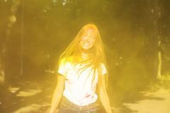 Cheerful blonde model having fun at Holi paint party Royalty Free Stock Photos