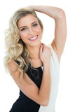 Cheerful blonde model holding her head Royalty Free Stock Images