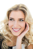 Cheerful blonde model looking up Royalty Free Stock Photography