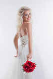 Cheerful blonde posing in stylish wedding dress Royalty Free Stock Photo