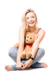 Cheerful blonde with a teddy bear Stock Photography