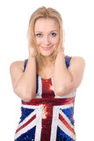 Cheerful blonde wearing union-flag shirt Stock Photography