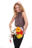 Cheerful blonde woman with a flower bouquet Royalty Free Stock Photography